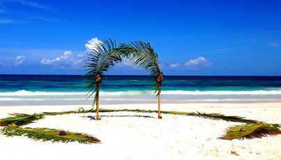 Tulum beach palm leaf arbor